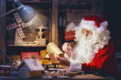 Santa Claus is preparing gifts Royalty Free Stock Photography