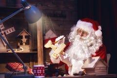 Santa Claus is preparing gifts Stock Photos