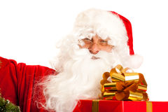 Santa Claus with present Royalty Free Stock Photos