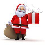 Santa claus with a present Royalty Free Stock Photo