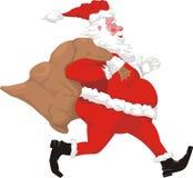 Santa claus with present sack Stock Photo