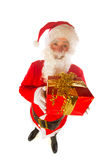Santa Claus with present for you Royalty Free Stock Image