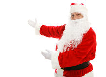 Santa Claus Presenting. Santa Claus with his arms out in a presenting gesture.  Isolated design element Stock Images