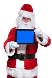 Santa claus presenting the blank screen of tablet pad Royalty Free Stock Photos