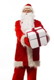 Santa Claus presenting gift box Royalty Free Stock Images