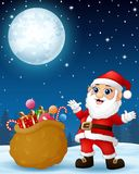 Santa Claus presenting sack full of gifts in the winter night background Royalty Free Stock Photography