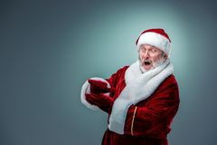 Santa Claus, presenting something. Royalty Free Stock Photo