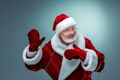 Santa Claus, presenting something. Royalty Free Stock Photography