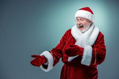Santa Claus, presenting something. Stock Photos