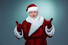Santa Claus, presenting something. Royalty Free Stock Images