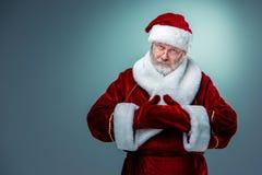 Santa Claus, presenting something. Royalty Free Stock Image