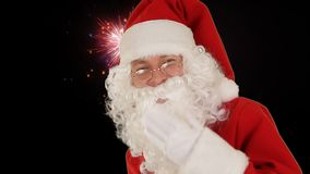 Santa Claus Presenting a White Sheet and sending a kiss against holiday fireworks stock video footage