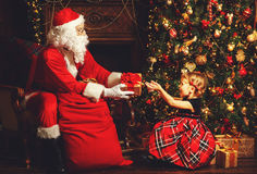 Santa Claus presents Christmas gift happy child Stock Images