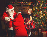 Santa Claus presents Christmas gift happy child Stock Photo
