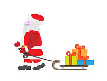 Santa claus and presents Royalty Free Stock Photos