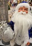 Santa Claus with presents and toys Stock Image