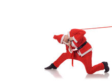 Santa Claus pull red ribbon Royalty Free Stock Photos