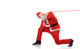 Santa Claus pull red ribbon Stock Photos