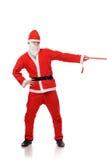 Santa Claus pull red ribbon Royalty Free Stock Image
