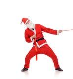 Santa Claus pull red ribbon Royalty Free Stock Photography