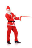 Santa Claus pull red ribbon Stock Image