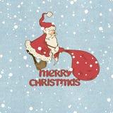 Santa Claus pulling big sack Royalty Free Stock Photo