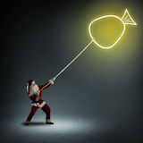 Santa Claus pulls a symbol bag with a gifts Stock Images