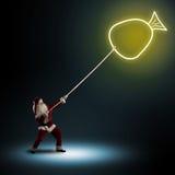 Santa Claus pulls a symbol bag with a gifts Stock Photos