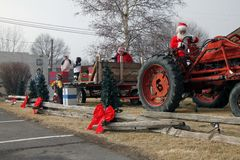 Santa Claus pulls a tractor with carolers Royalty Free Stock Images
