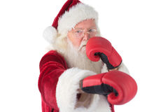 Santa Claus punches with his right Royalty Free Stock Photography