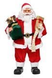Santa Claus-Puppe mit Geschenk- und Symboltabellefrontansicht Stockfoto