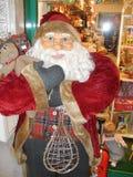 Santa Claus-Puppe, mit Gläsern stockfotografie