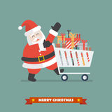 Santa claus push a shopping cart with piles of presents Royalty Free Stock Photo