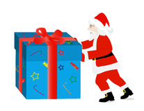 Santa Claus pushes a gift Royalty Free Stock Photography