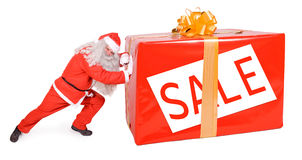 Santa Claus pushing big package. Santa Claus with Christmas box isolated on white background Stock Image