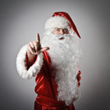 Santa Claus pushing the button Royalty Free Stock Photos