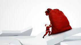 Santa Claus pushing huge red sack. Full of gifts Royalty Free Stock Photography