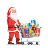 Santa Claus pushing shopping cart full of gifts Stock Photo