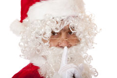 Santa Claus puts finger on lips for silence Stock Photography