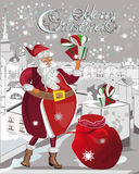 Santa Claus puts the gifts into the chimneys. Stock Images