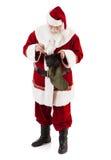 Santa Claus Putting Gift Into Christmas-Strumpf Stockbilder