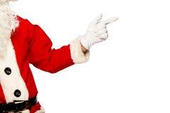 Santa Claus que aponta o sinal com o sorriso, isolado sobre Fotos de Stock Royalty Free