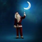 Santa Claus que guarda uma lua de brilho Fotos de Stock Royalty Free