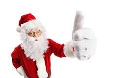 Santa Claus que hace un pulgar encima del gesto foto de archivo libre de regalías