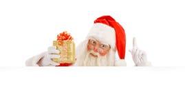 Santa Claus que lleva a cabo una muestra Imagen de archivo