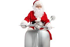 Santa Claus que monta una vespa del vintage imagen de archivo