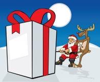 Santa Claus que puxa o presente Fotografia de Stock