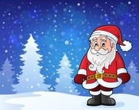 Santa Claus que se coloca en nieve Fotografía de archivo libre de regalías