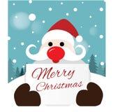 Santa Claus que sostiene la tarjeta Imagen de archivo