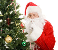 Santa Claus - Quiet. Santa Claus is very quiet as he leaves gifts on Christmas morning. Isolated on white stock photo